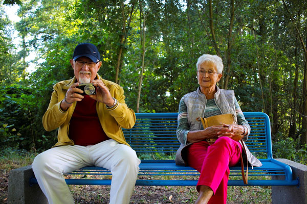 Grandparents sitting on bench